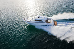 Luxurious boat racing through the ocean Royalty Free Stock Photography
