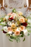 Bouquet of flowers in the hands of the bride stock photography