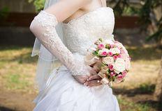 Luxurious bouquet in brides hand Royalty Free Stock Image