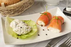 Luxurious breakfast. Tasty and luxurious breakfast - salmon rolls with cottage cheese Stock Images