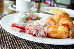 Luxurious Breakfast In Five Star Hotel. Typical Ham with Sushi and Croissant Royalty Free Stock Photo