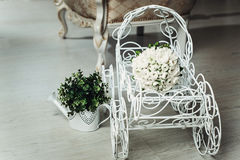 Luxurious bridal bouquet of white peonies on a white decorative cart stock image