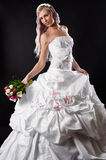 Luxurious bride in wedding dress with a bouquet Royalty Free Stock Photo