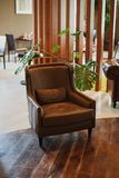 Luxurious brown leather chair at the hotel reception lounge. royalty free stock photo
