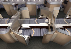 Luxurious business class cabin interior. Each seat divided by frosted acrylic partition Royalty Free Stock Images