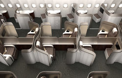 Luxurious business class cabin interior with metallic gold partition. Stock Photo