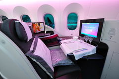Luxurious business class seat of a Qatar Airways Boeing 787-8 Dreamliner at Singapore Airshow. SINGAPORE - FEBRUARY 12: Luxurious business class seat of a Qatar Royalty Free Stock Images
