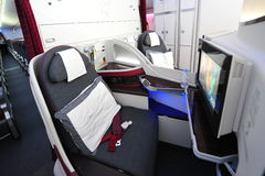 Luxurious business class seats onboard Qatar Airways Boeing 787-8 Dreamliner at Singapore Airshow stock image