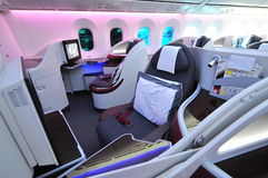 Luxurious business class seats onboard Qatar Airways Boeing 787-8 Dreamliner at Singapore Airshow stock photos
