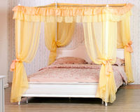 Luxurious canopy bed Stock Image