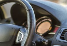 Luxurious car interior. Dashboard and steering wheel in black gray color. Transportation, design, modern technology concept. Luxurious car interior. Dashboard royalty free stock image