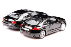 Luxurious cars. Two expensive and luxurious cars back view on white background stock images