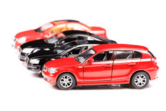 Luxurious cars. Expensive and luxurious cars lined up on white background royalty free stock photos