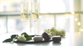 Luxurious champagne wedding party with white roses and macaron desserts, holiday celebration. With wine stock footage