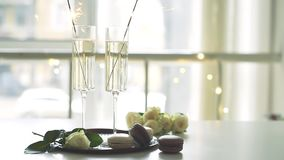 Luxurious champagne wedding party with white roses and macaron desserts, holiday celebration with wine. And sparklers stock video footage