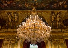 Luxurious chandelier at Napoleon III apartments, Louvre museum, Paris France. Luxurious chandelier at the Napoleon III apartments located in the Richelieu Wing stock image