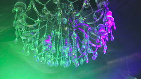 Luxurious chandelier spinning and shining, background stock video footage