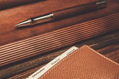 Luxurious charcoal drawing pencils. Luxurious rollerball pen and desk pad Stock Photo