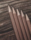 Luxurious charcoal drawing pencils. On a wooden table Royalty Free Stock Images