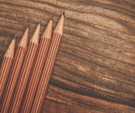 Luxurious charcoal drawing pencils. On a wooden table Royalty Free Stock Photography