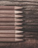 Luxurious charcoal drawing pencils. On a wooden table Royalty Free Stock Photos