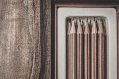 Luxurious charcoal drawing pencils. On a wooden table Stock Image