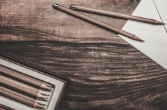 Luxurious charcoal drawing pencils. On a wooden table Stock Photo