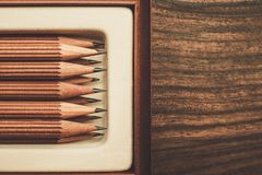 Luxurious charcoal drawing pencils. On a wooden table Stock Photography