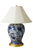 Luxurious Chinese lamp with clipping path. White-blue ceramic lamp with golden details and clipping path Royalty Free Stock Images