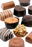Luxurious chocolates. Set of luxurious decorated chocolates isolated on white background Stock Images