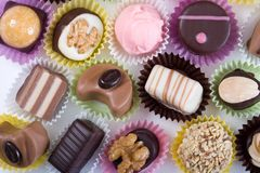 Luxurious chocolates. Close up of luxurious chocolates in colorful cases Royalty Free Stock Photo