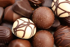 Luxurious chocolates. Close up of pile of luxurious, decorated chocolates Stock Photography
