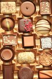 Luxurious Chocolates in box. Luxurious Chocolates in various shapes and flavors in a gift box Stock Images
