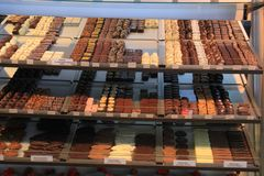Luxurious Chocolates at a store display. Luxurious Chocolates on display in a confectioner`s shop tags: price and product information in Dutch Stock Photos