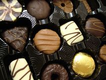 Luxurious chocolates in tray. Close up of luxurious chocolates in tray Stock Photos