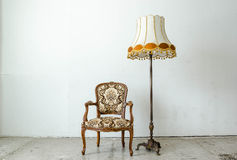 Luxurious classical vintage armchair with desk lamp Royalty Free Stock Photos