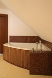 Luxurious corner bathtub Royalty Free Stock Photography