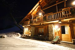 Luxurious cottage. Luxurious french cottage by night with snow. Typical chalet for christmas or winter holidays Royalty Free Stock Photo