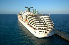 Luxurious Cruise ship. White Cruise ship docked in the port Stock Photos