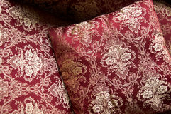 Luxurious cushions on bed in gold brocade Royalty Free Stock Photography