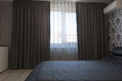 Luxurious dark curtains in the bedroom.  royalty free stock photo