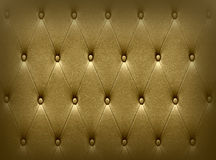 Luxurious dark golden leather  seat upholstery Royalty Free Stock Photography