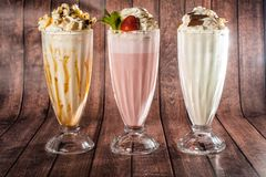 Nice drinks with a lot of ice cream in combination with mint, green apple, cocoa, vanilla. royalty free stock photos
