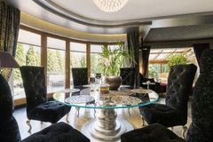 Luxurious dining room with glass table Stock Photos