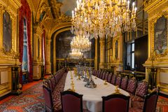 Luxurious dining room interior with royal furniture, Napoleon III apartments, Louvre museum, Paris France. Luxurious dining room with chandeliers at the Napoleon stock photography