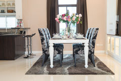 Luxurious dining room. The white Luxurious dining room royalty free stock photography
