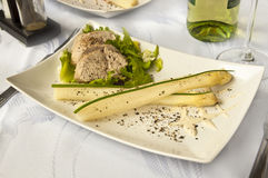 Luxurious dinner - pork sirloin with asparagus and wine Stock Photos