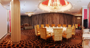 Luxurious dinning room. Luxury dinning room with royal style stock photography