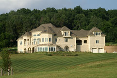 Luxurious executive home. Build high on a hill in the country royalty free stock image