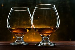 Luxurious and expensive French brandy in a glass stock images